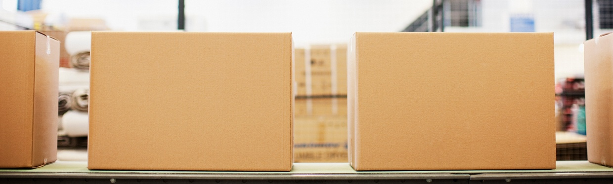 Boxes-in-row-in-shipping-area-1240px.jpg