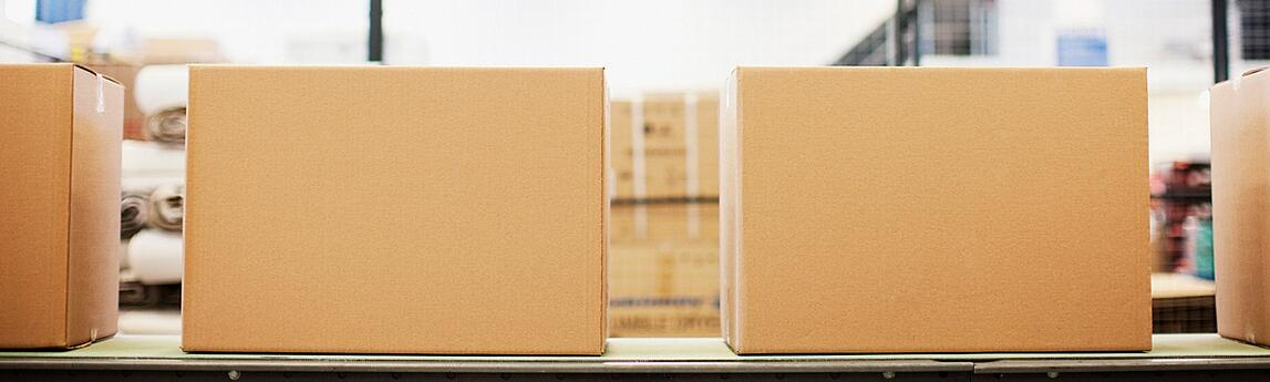 Boxes-in-row-in-shipping-area-1240px-1.jpg